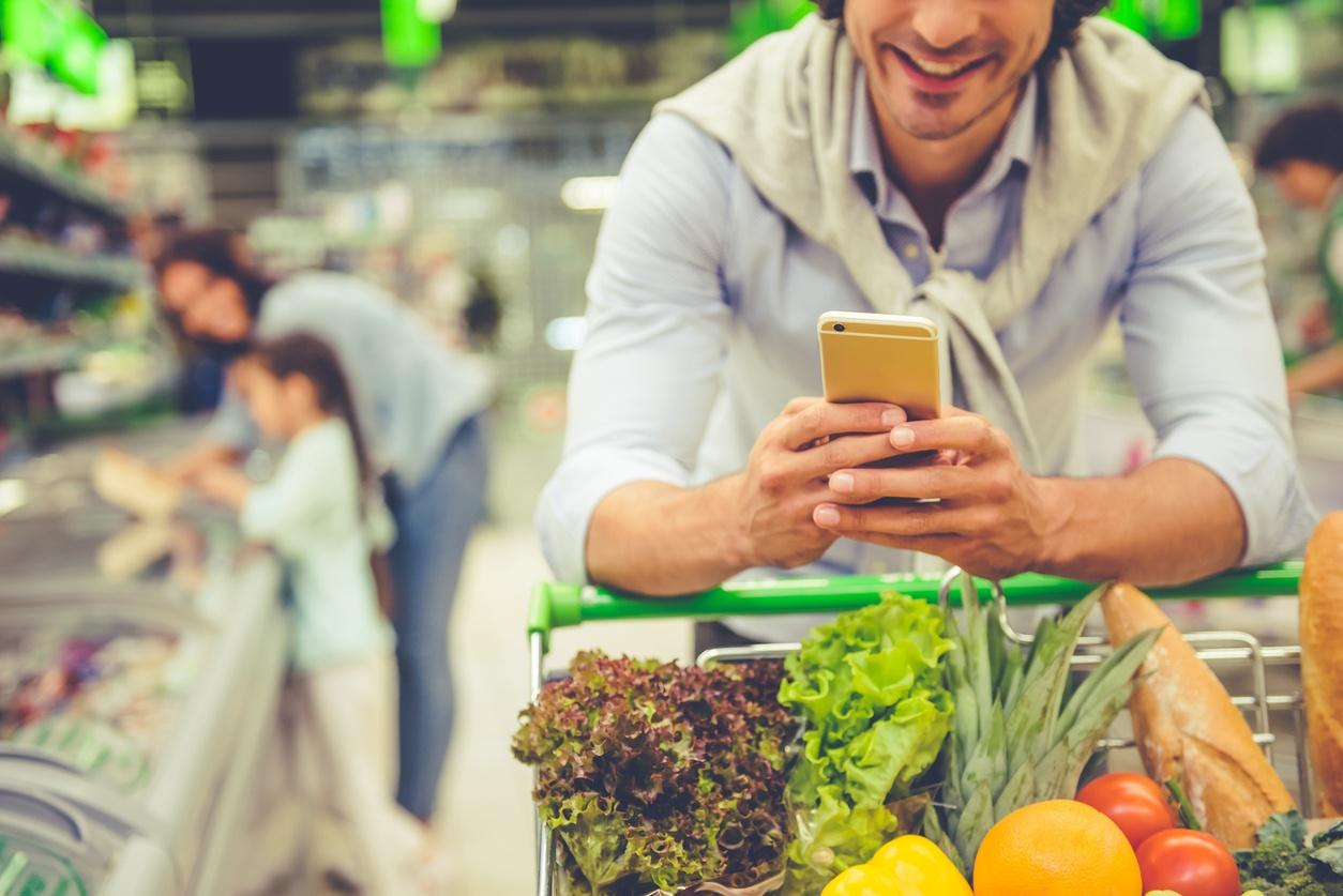 supermarket man phone.jpg