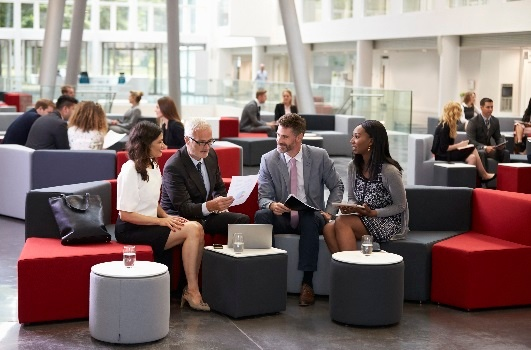 Businesspeople-Meeting-In-Busy-Lobby-Of-Modern-Office-600072506_2125x1416 (1) - Copy.jpeg